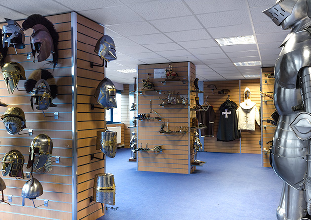 The Knight Shop showroom - medieval helmets display