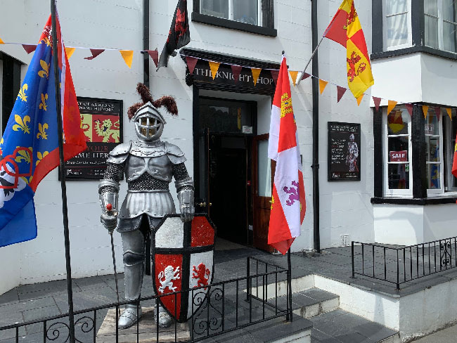 The shop entrance outside with knight statue