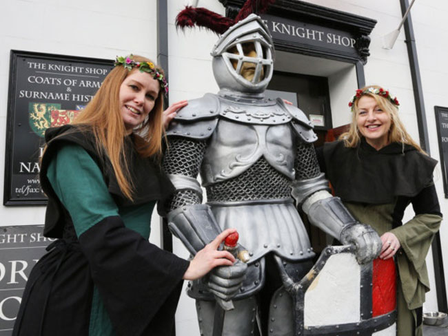 Staff dressed in medieval costumes at the Knight shop